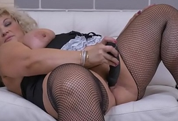 Euro gilf Renatte pleasures her chesty pussy with regard to a dildo